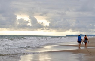 c-Love_is_seeing_Father_and_daughter_enjoy_a_precious_evening_beach_walk