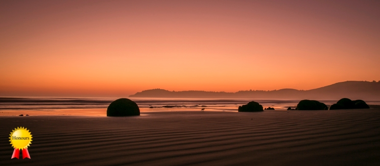 a-sunrise over moeraki boulders