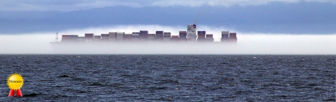 b-Container.ship.sailing.through.the.sea.fog